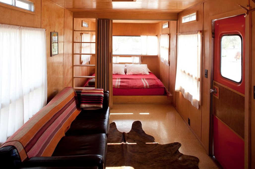 Bedroom and Bed By reducing the bedroom to its essentials and filling it with windows, the El Cosmico staff has made this small space as expansive as the desert beyond.  Photo 2 of 9 in Hotels We Love: El Cosmico Hotel in Marfa, Texas