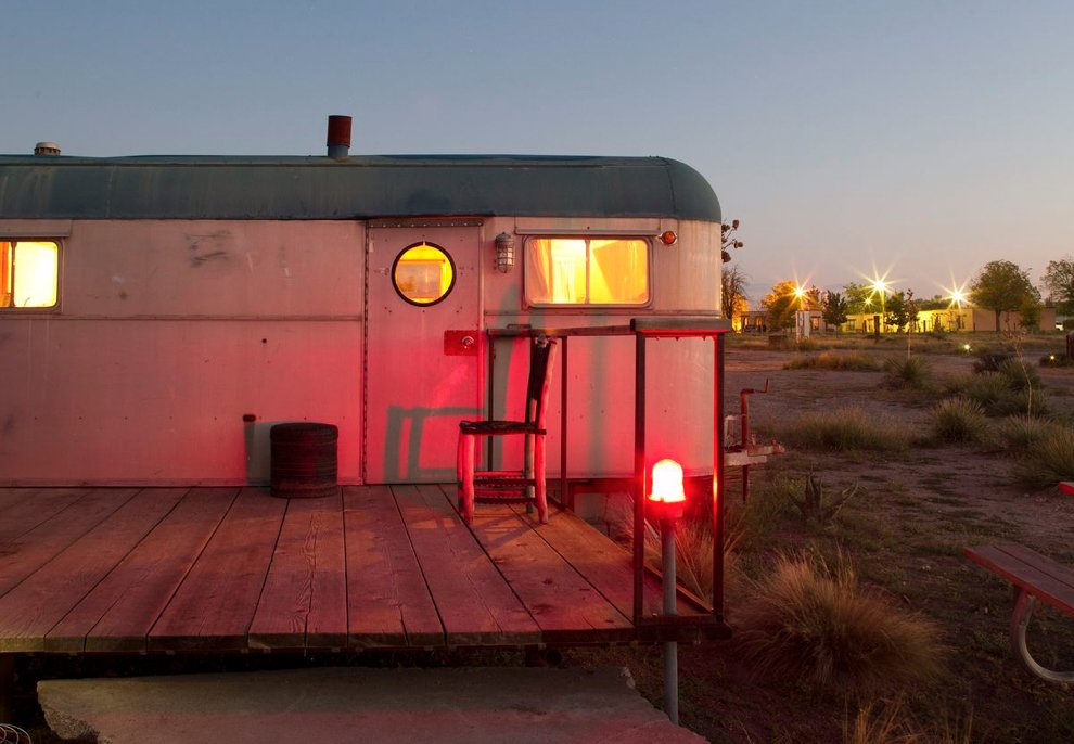 Exterior, Camper Building Type, and Metal Siding Material With the residents awake inside, this trailer's burnished glow reflects the sunset.  El Cosmico from Hotels We Love: El Cosmico Hotel in Marfa, Texas