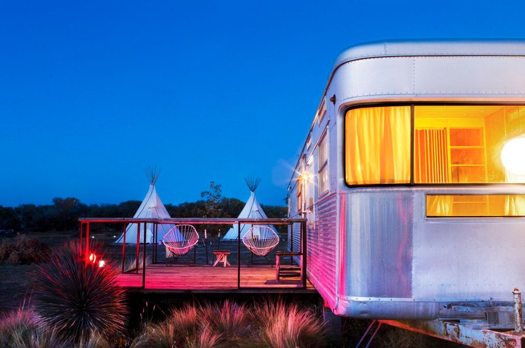 Exterior, Camper Building Type, and Metal Siding Material Night settles in around the wanderers sheltered in El Cosmico's teepees and trailers. As El Cosmico shows, understanding a small space involves understanding the infinitude of the world beyond them.  Photo 8 of 9 in Hotels We Love: El Cosmico Hotel in Marfa, Texas