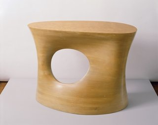 Laminated Wooden Table (1941) While Noguchi's other tables are certainly more famous, this unique piece, a gift to Philip L. Goodwin, who designed the MoMA building, showcases the forms and curves found in his sculpture at the time. Photo courtesy of The Noguchi Museum, New York.