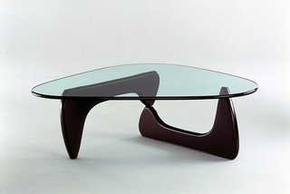 """Noguchi Coffee Table (1944)A Herman Miller classic, modernist icon and Tumblr inspiration, this three-piece table is the epitome of simple, focused design. Initially made in 1939 for MoMA president A Conger. Goodyear, Noguchi's work in ebonized walnut remains a touchstone. """"Even the first table I made for Conger Goodyear was not exactly utilitarian,"""" he said. """"I thought of it as sculpture that was a table. After all, you can say that the earth is a table. We feast upon it. You can also say that it is utilitarian, this earth."""" Photo courtesy of The Noguchi Museum, New York."""