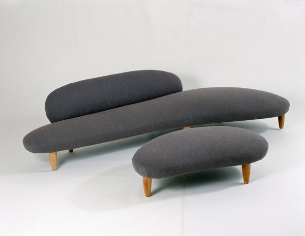 Freeform Sofa (1946)Noguchi's fixation on organic shapes is evident in this fluid piece of furniture, a soft, warm and inviting seat with a matching ottoman with matching contours. Photo courtesy of The Noguchi Museum, New York.