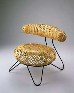 Bamboo Chair (1950)A prototype that was recreated from photos, this lost design came out of a collaboration between Noguchi and Japanese design Isamu Kenmochi. Noguchi laid out the curved metal forms while Kenmochi's weaving skills led to the flowering base and curved backrest. Photo courtesy of The Noguchi Museum, New York.