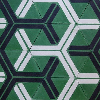 Handmade in Morocco from locally sourced materials using a traditional, 150-year-old technique, these encaustic cement tiles from Popham Design are durable and non-toxic. We love the bright kelly green and bold hexagonal patterning.  How to Design with Hexagon Patterns by Erika Heet from Eco-Friendly Tile Designs for Spring