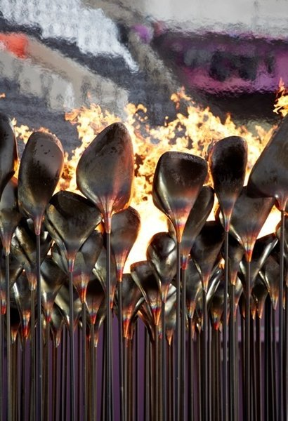 "Olympic CauldronA billion people tuning into the Olympics' opening ceremony meant all eyes on the torch—or at least on the person carrying it. Heatherwick says nobody remembers the Olympic Cauldron. ""People remember people, not objects."" So the London Olympics featured seven young athletes carrying copper cones of fire—""Gold, silver, and bronze were busy for those two weeks""—and touched the cauldron with their torches until the flames spread around in circles. Some 204 stems, each representing a country, rose together to form a single massive flame—truly more than the sum of its parts.  Photo by: Edmund Sumner"