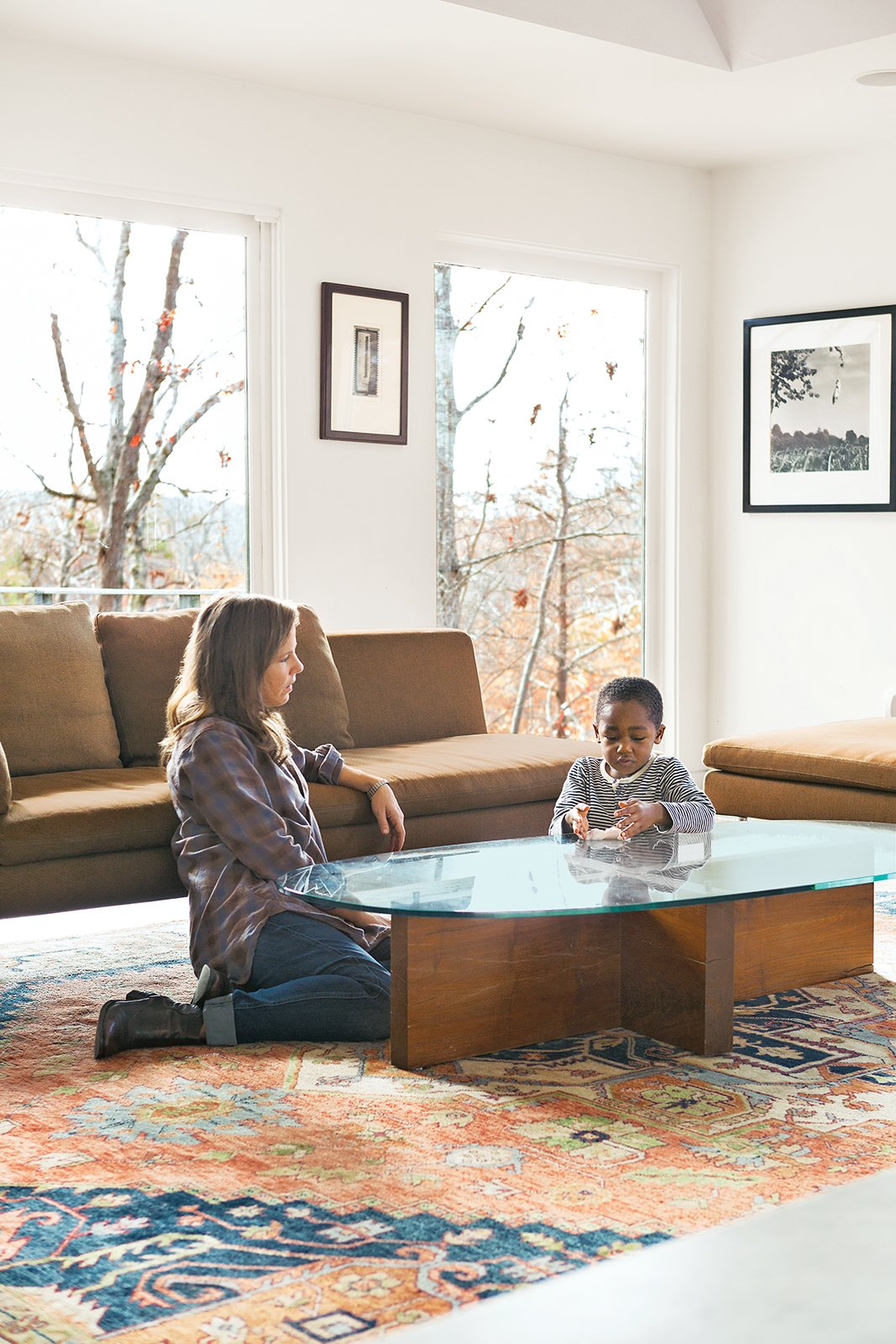 Living Room, Coffee Tables, Rug Floor, Chair, and Concrete Floor Birdsall plays with her son Atticus in the living room next to a Charles sofa from B&B Italia. Formwork also designed the coffee table—fitting, since the architects come from strong fabrication backgrounds.  Photo 3 of 16 in How This Landscape Design Made a Home as Fun as a Playground