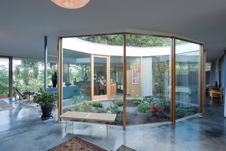 """The Heids incorporated mostly native plants into the courtyard, which Andrew designed as an ovoid decagon. The George Nelson Platform bench is from Design Within Reach. Solarban low-e glass improves insulation. The layout, says Andrew, is meant to """"bring people together."""""""