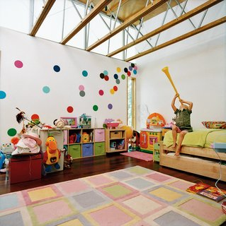 Ella's bedroom sports walls covered in polka dots that JJ hand-cut from fabric.