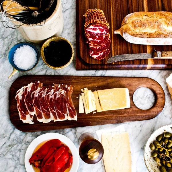 Made from rich, solid walnut wood, Geoffrey Lilge's 6.1.2 Hole Slab Long Serving Board (from On Our Table) is finished with a beeswax and natural oil varnish. It's sculptural form is perfect for hosting the snacks, cheese, and charcuterie that may accompany your libations.