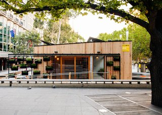 Australian firm Archiblox built the world's first energy positive prefab and then displayed it in the middle of Melbourne's city square for all to see. The house has large double-glazed windows that bring sunlight and warmth into the structure during winter. The garden walls also wrap over the roof of the structure to further insulate the home and act as a living roof.