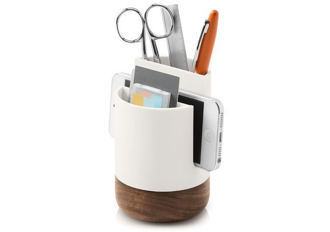 """The slotted cup ($25) has a place to stow a smartphone along with traditional items like pens and Post-Its.  """"Workspaces have changed to be more open—a lot less privacy and a bigger emphasis on communal-use spaces,"""" Pfeiffer says. """"The desktop and where you physically work still needs objects that both impart personality and comfort and also create order. The Pfeiffer Collection creates order for the desktop, but also recognizes the need to be modular and accommodate the way we work today. I believe people looking for desktop objects that work well together, work well with their particular office environment, and with the devices and tools they use. We think the Pfeiffer Collection accomplishes this.""""  The Modern Desk Accessories You Need to Own by Diana Budds"""