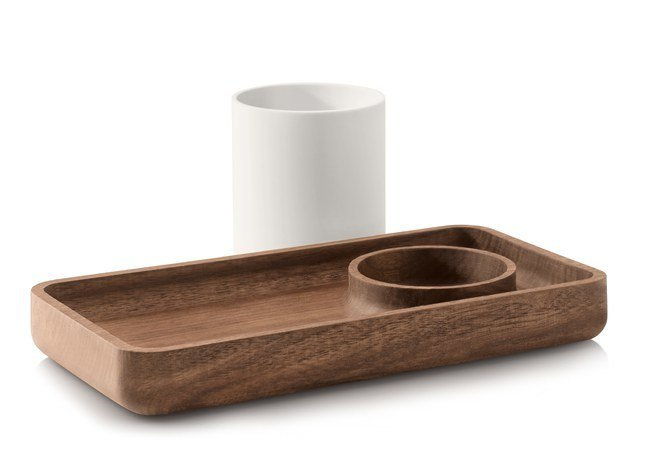 """The most challenging aspect of the design was bringing together the wood and plastic, Pfeiffer says. """"The intersection of these two dissimilar materials requires tight tolerances between two materials that move at very differently rates. It took some time to getting this right!"""" The cup on the Catch All Tray ($45) can be used atop the tray or removed to reveal a spot to corral smaller items.  The Modern Desk Accessories You Need to Own by Diana Budds"""