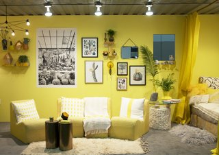 Interior designer Justina Blakeney created this yellow space for YP at Dwell on Design Los Angeles 2015, showing that a room filled with a single continuous color can be comfortable and inviting.