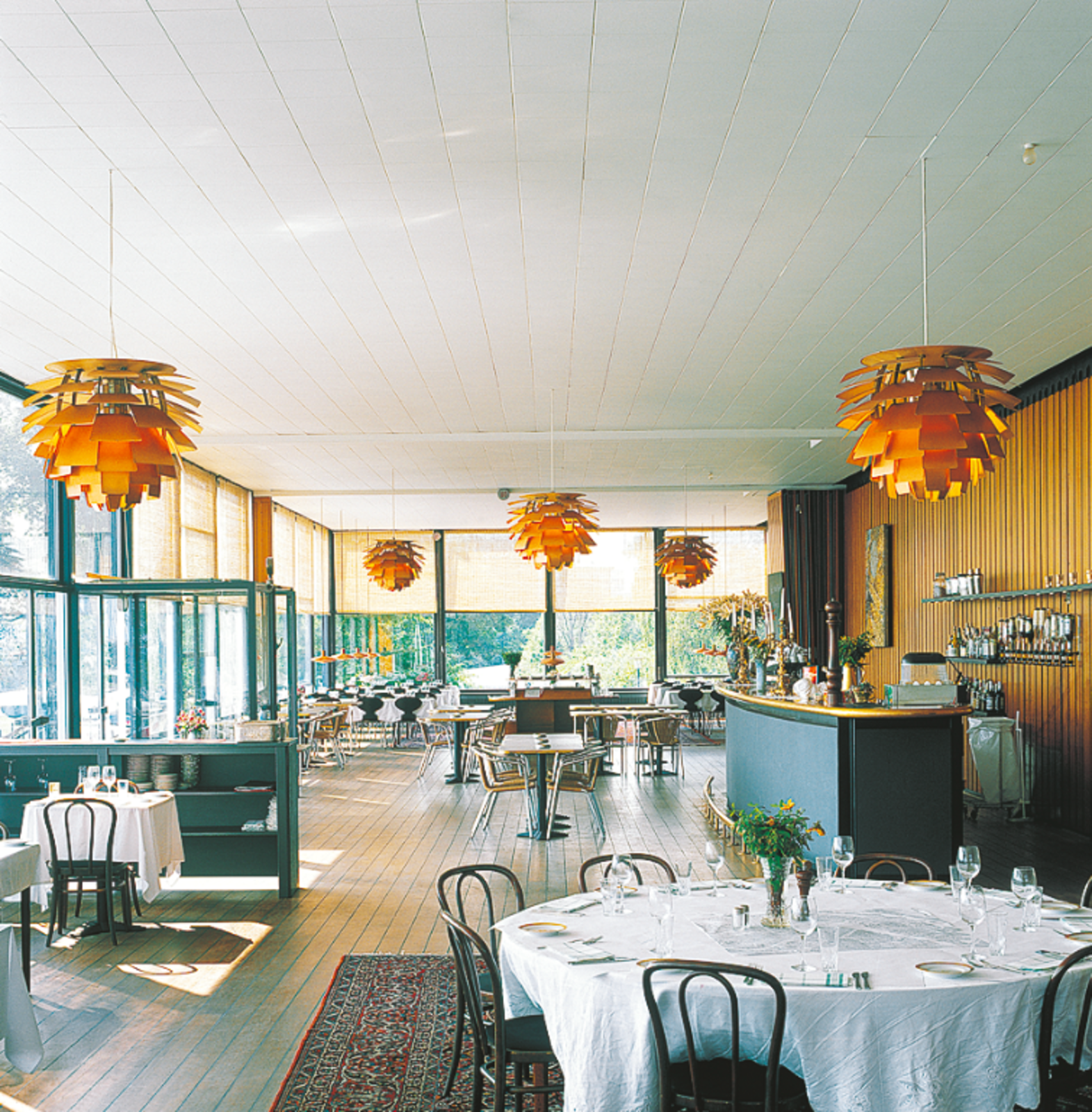 A shot of the Langelinie Pavilion today, with original PH Artichoke pendants hanging throughout the restaurant.  Photo 3 of 7 in The Lighting Fixture That Inspired A High-Stakes Heist: The PH Artichoke