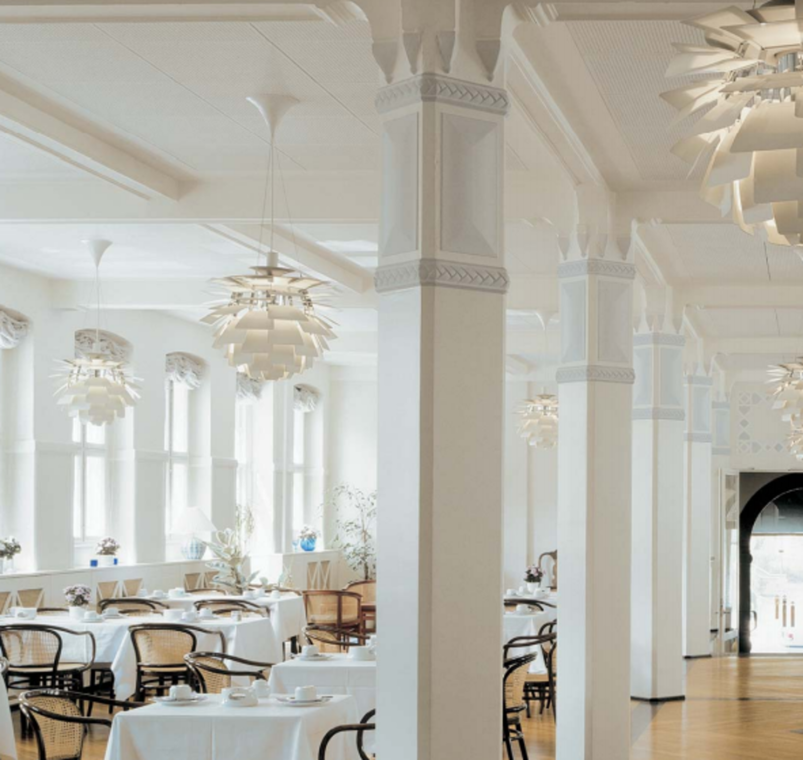 The simplicity of the PH Artichoke complements the architectural details of the Ascot Hotel in Copenhagen.  Photo 7 of 7 in The Lighting Fixture That Inspired A High-Stakes Heist: The PH Artichoke
