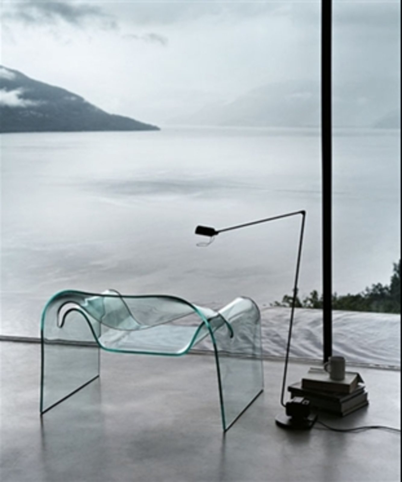 """Designed by Cini Boeri for Fiam, the half-inch-thick thick curved glass Ghost chair is well-suited for those who want their seating to disappear into the background.  Search """"joe colombo 4801 armchair"""" from Nearly Invisible Modern Furnishings"""