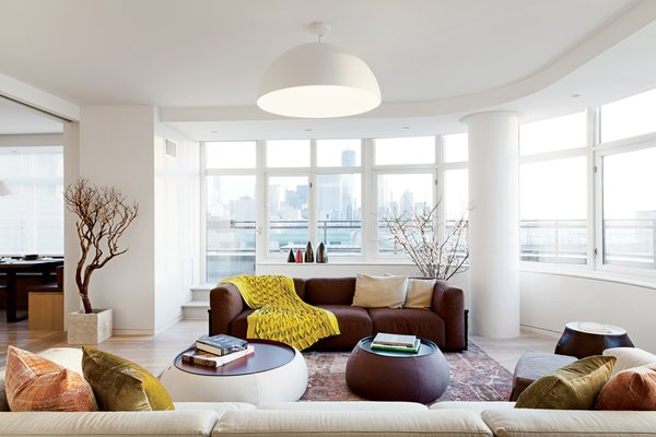 Mex sofas by Cassina and Fat Fat-Lady Fat tables from B&B Italia are grouped in the living room.