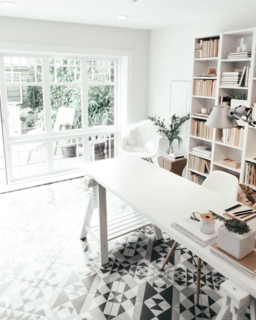 @andrea_mclean took a garage in Vancouver and turned it into a minimalist work area. The designer credits the geometric tile and reclaimed windows for making the space pop.