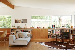 Among designer furniture from Antonio Citterio and Arne Norell, built-ins filled with books line the living room of this Los Feliz, Los Angeles, renovation.