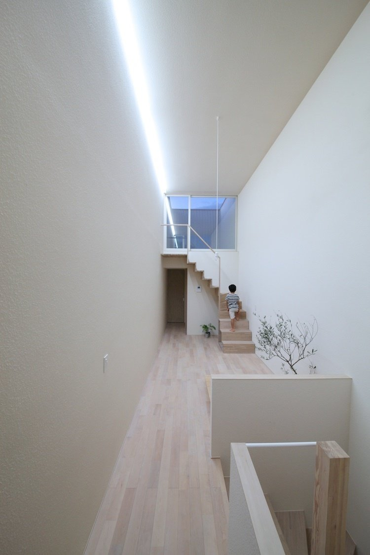 Imai House by Katsutoshi Sasaki + Associates  Sasaki realized that with limited floor space, he couldn't be bound by assigned roles for each room. He concentrated on airy, open, and overlapping environments.  Photo provided by Katsutoshi Sasaki + Associates  Stairs