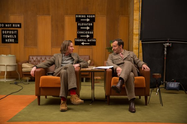 """Wes Anderson and Jude Law on the set. """"We realized pretty quickly there was no way we could do what we needed to do in a real hotel,"""" says Stockhausen, who worked with Anderson before on Moonrise Kingdom and The Darjeeling Limited. """"A real hotel has its own guests, its own thing going on, and there's no way we can take it over for the amount of time we need to. We couldn't build the whole thing from scratch, either, we'll never be able to afford it."""""""