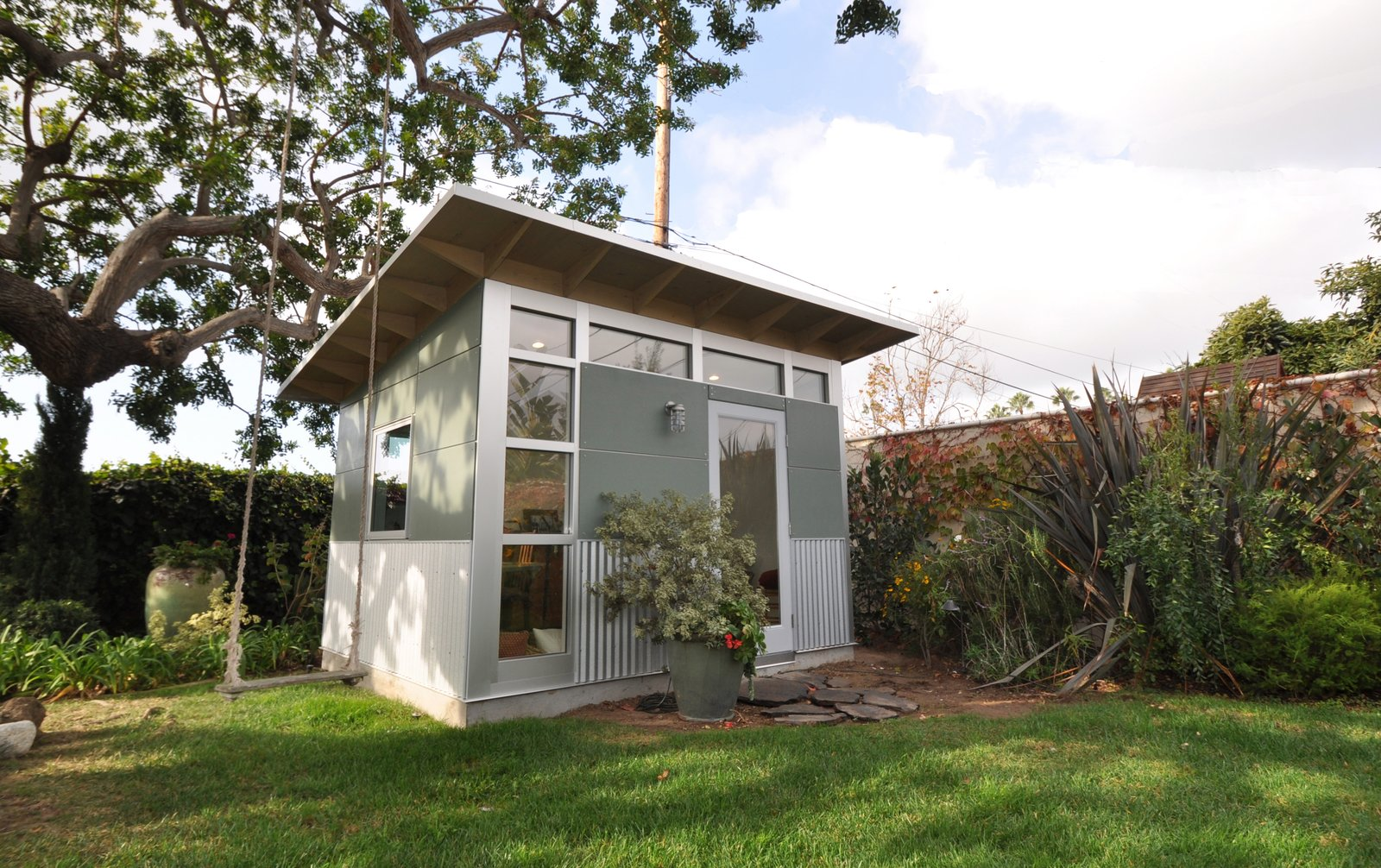 """Insulated with denim and highly sealed, the sheds can also double as an outdoor room, like this outdoor living room in Palo Alto, California.  Search """"shed-&-studio"""" from Backyard Escapes and Retreats We Love"""