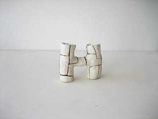 """4. Ceramic Double Vase by Dino Matt""""My boyfriend and co-owner Dino makes a small amount of one-of-a-kind pieces for the shop. My favorite thing about this vase is the channel  in the middle that allows water to pass from side-to-side. He makes these in a variety of sizes. I'm happy to be the official tester of his prototypes before they make it into the shop. The double handled mugs are a collaboration: I had a dream he was making mugs with two handles side-by-side, so he made it happen. It's a great feeling to hold two handles next to each other, and it looks cool."""""""