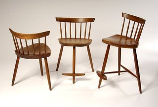 These three-legged chairs were designed in 1950 for George's daughter, Mira, who now runs George Nakashima Woodworker, the company that carries on the Nakashima legacy.