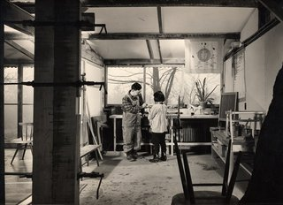 George Nakashima with his daughter Mira in his workshop.