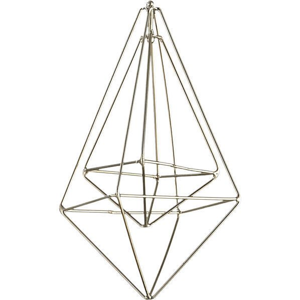 The Wire Drop Silver Ornament by CB2 shows that negative space, when carved out by a wire frame, can be a beautiful thing.