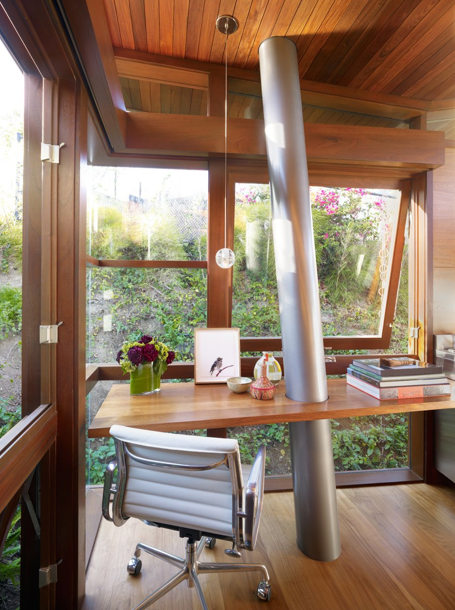 Office, Desk, and Study Room Type Materials and craft play a significant role inside and out. The columns are Type 316 stainless steel – almost nautical grade. Floors and walls are walnut; windows are mahogany.  Photo 7 of 11 in An Atypical Tree House