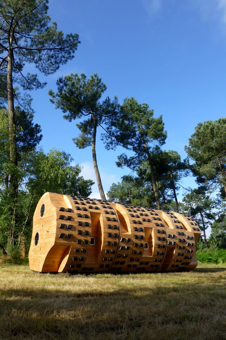 """A different kind of log cabin, """"Le tronc creux"""" is an abstract wood cylinder concieved by Bruit du frigo Thidet and built by Zebra3.  Photo 5 of 8 in Tiny Vacation Shelters in the French Countryside"""