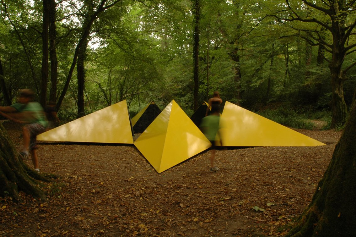 """Sréphane Thidet conceived of """"La belle étoile,"""" a yellow, star-shaped shelter made of stainless steel and wood.  Photo 6 of 8 in Tiny Vacation Shelters in the French Countryside"""