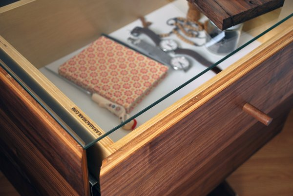 A detail shot of the Adib Pacha highlights the easily accessible, glass-topped drawer.