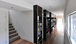 A bank of built-in shelves lines the hallway.