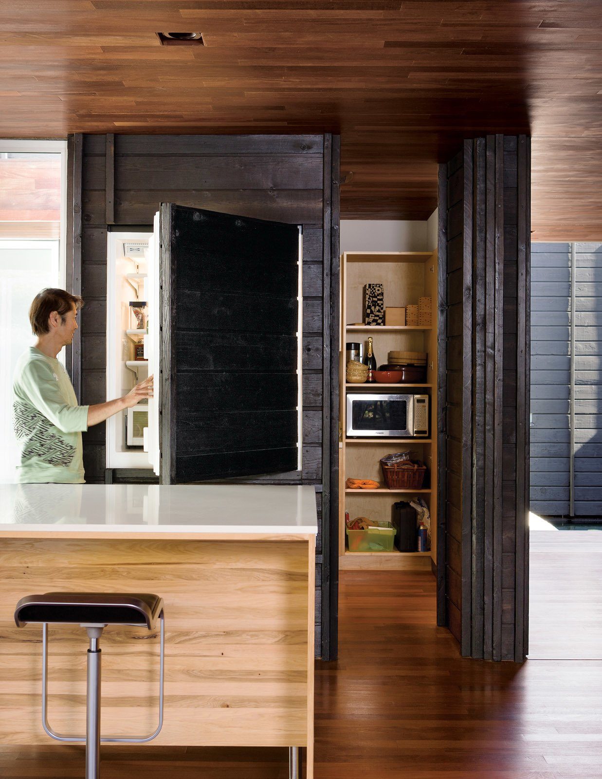 Kitchen, Wood Cabinet, Refrigerator, Ceiling Lighting, White Cabinet, Recessed Lighting, and Medium Hardwood Floor While most of the ground level is given over to the large open living and dining area, it also includes a small pantry, office, and Japanese bathroom. An integrated Sub-Zero refrigerator is almost unnoticeable behind its charred cedar cladding.  Hail Cedar: 7 Houses that Make Use of Cedar Wood by Diana Budds from An Atypical Modern Home in Southern California