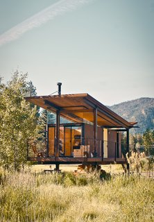 "The steel-clad Rolling Huts designed by Olson Kundig Architects in Manzama, Washington, sit lightly on the land thanks to wheels that allow the tiny residences to ""hover"" above the site, optimizing views of the landscape. Photo by Derek Pirozzi."