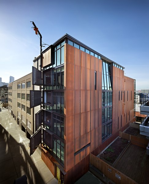 Built on the site of a former horse stable, Art Stable is a mixed-use infill project in Seattle, Washington, that boasts an 80-foot-tall hinge for hand-cranked doors. Photo by: Benjamin Benschneider.