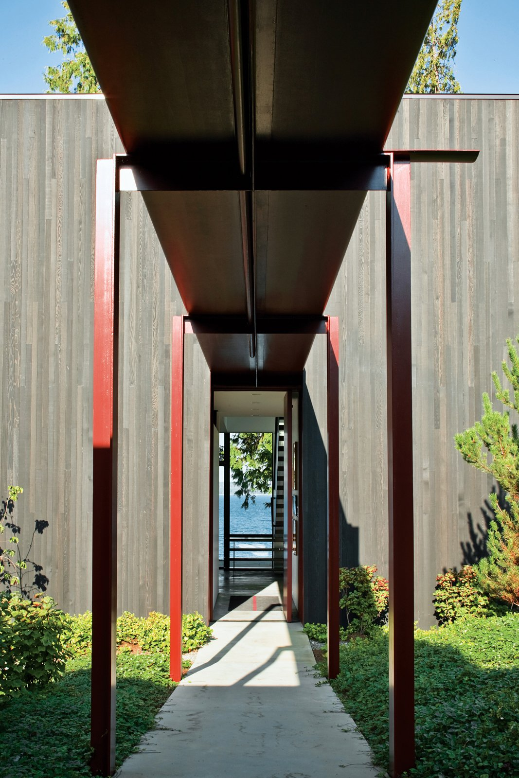 Exterior and House Building Type The steel canopy protects the residents from Seattle's notoriously rainy weather as they walk from the entry gate to the front door.  Dwell on Design Preview: Tom Kundig Collection by Jaime Gillin from Olson Kundig Houses