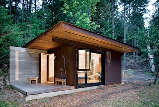 "This 191-square-foot cabin near Vancouver and its glass facades ""forces you to engage with the bigger landscape,"" architect Tom Kundig says, but it seals up tight when its owner is away. The unfinished steel cladding slides over the windows, turning it into a protected bunker. Read the full story here."