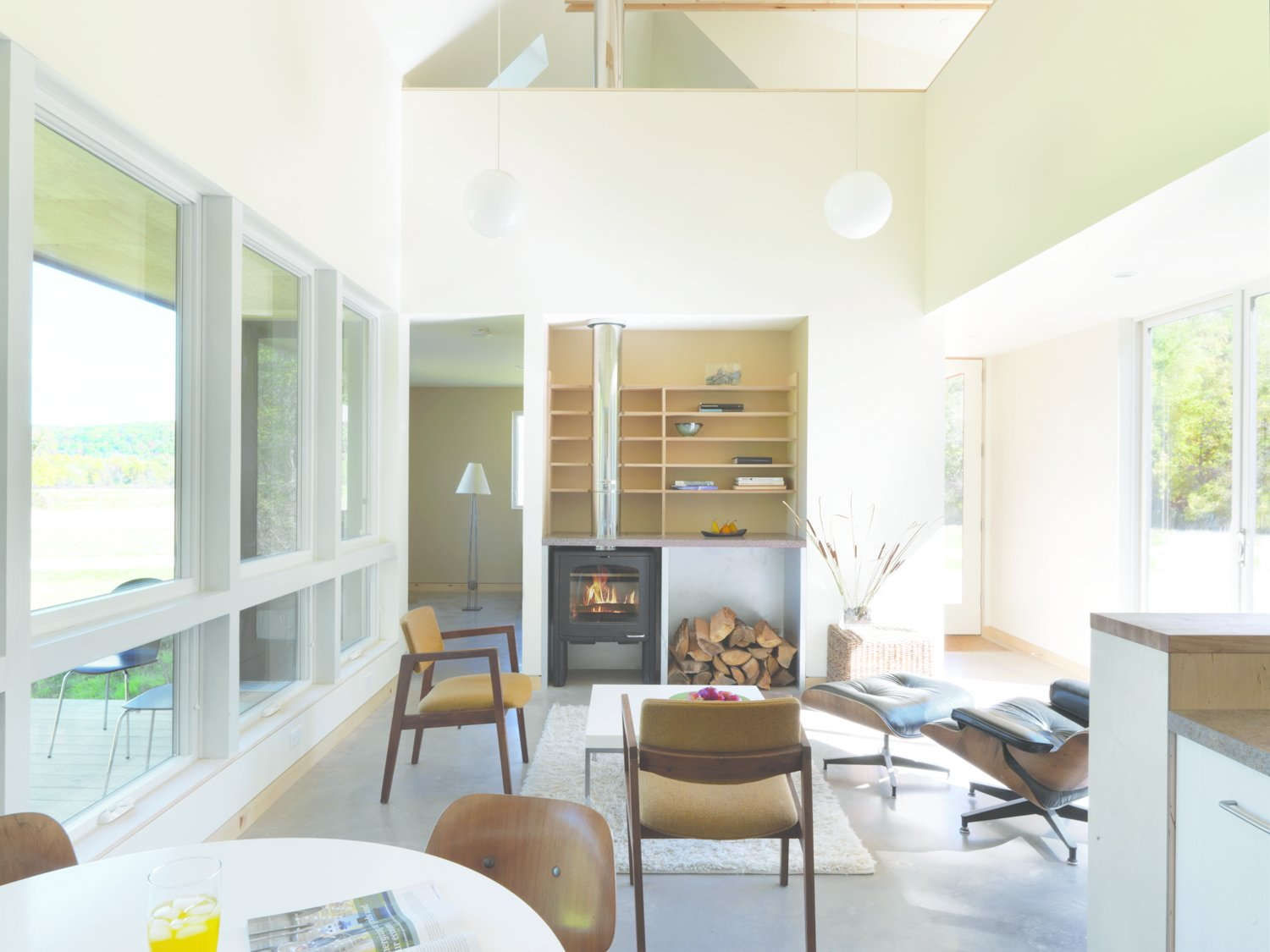 The house is a simple singular volume of the farmhouse is strategic: its one central space insulates to provide a place of refuge from New England's cold winters.  Photo 3 of 8 in McLeod Kredell: Locavore Architects in Vermont