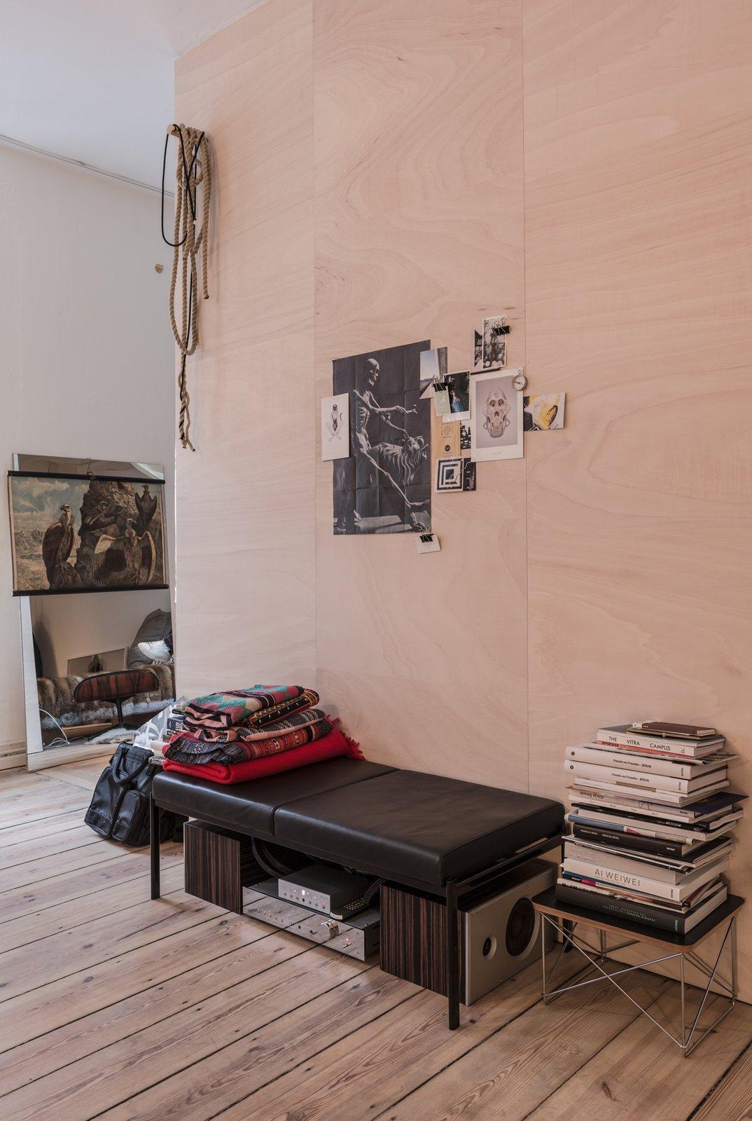 Salon of the Freunde von Freunden X Vitra Apartment  Unable to remove the center wall, architect Etienne Descloux instead created a wood-paneled centerpiece for the apartment.  Photo by Steve Herud  Photo 4 of 9 in Freunde von Freunden and Vitra's Berlin Apartment