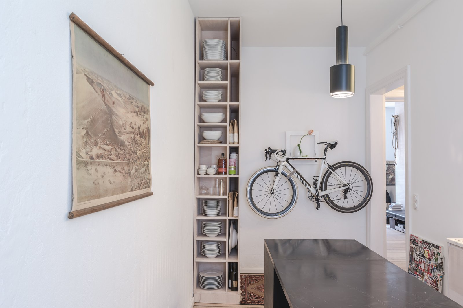 Kitchen of the Freunde von Freunden X Vitra Apartment  Architect Etienne Descloux adjusted the original bathroom design to provide more space for storage in the kitchen. Bike by Mikili, flowers by Marsano.  Photo by Steve Herud  Photo 7 of 9 in Freunde von Freunden and Vitra's Berlin Apartment