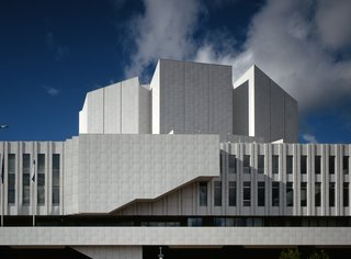 Finnlandia Hall is a centerpiece of the Finnish capital of Helsinki, boasting a towering auditorium and high roof, curving balconies, and an exterior of white marble and black granite.