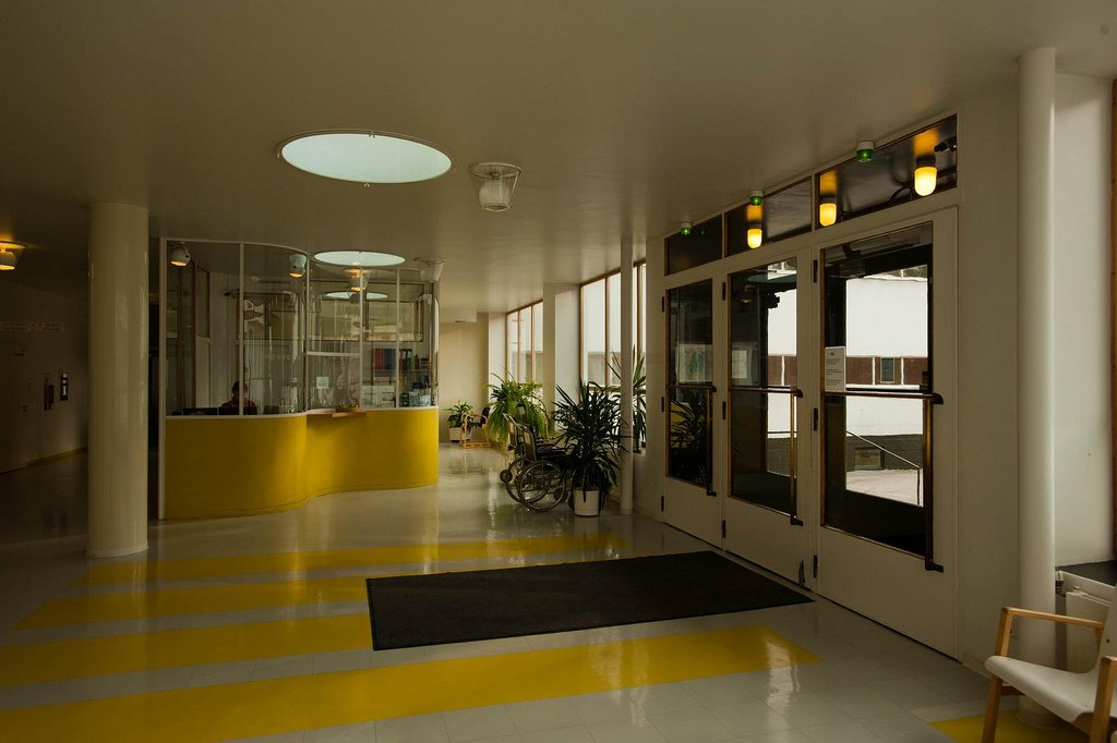 """Paimio Sanatorium (Paimio, Finland: 1933)  Aalto designed this sanitorium for tuberculosis patients to be a """"medical instrument,"""" a structure actively engaged in the healing process. Small touches, such as personal wash basins, glare-resistant interior paints and large balconies to soak up sunshine, came from his shrewd and empathetic observations (supposedly sick at the time himself, he realized that hospital rooms should have a """"horizontal"""" layout, since patients would spend most of their time in bed).  The furniture Alvar and his wife Aino created for the building can still be purchased through Artek.   (Credit: LeonL, creative commons)  Photo 9 of 11 in Design Icon: 10 Buildings By Alvar Aalto"""
