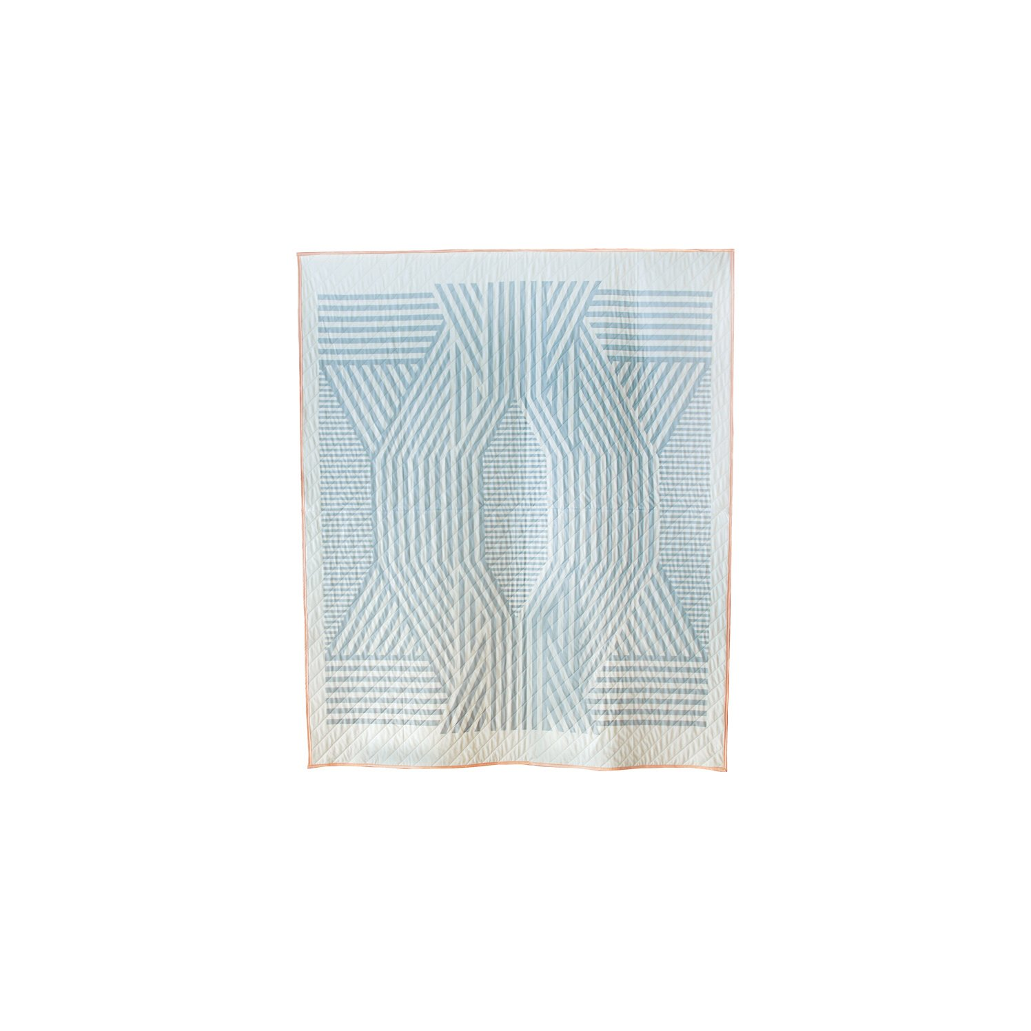 The pale blue Ada quilt is a perfectly symmetrical pattern thanks to Callahan's digital printing techniques. Available through the Dwell Store, $600.  Quilts for Modern Bedrooms by Olivia Martin