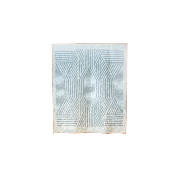 The pale blue Ada quilt is a perfectly symmetrical pattern thanks to Callahan's digital printing techniques. Available through the Dwell Store, $600.