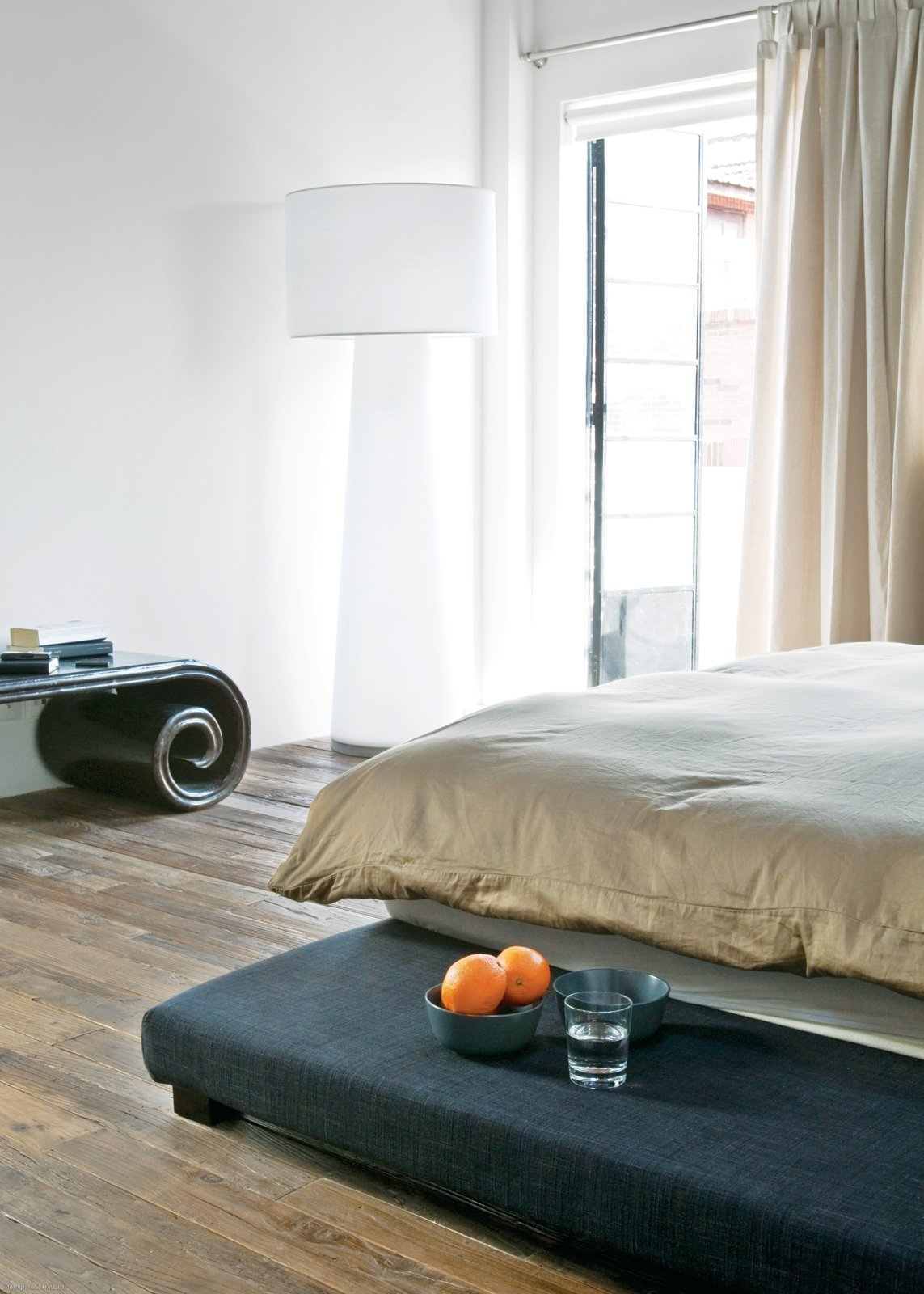Bedroom and Bed A Progetto Oggetto lamp by Marcel Wanders occupies a corner in the bedroom.  Photo 8 of 11 in Modern Lilong House Renovation in Shanghai