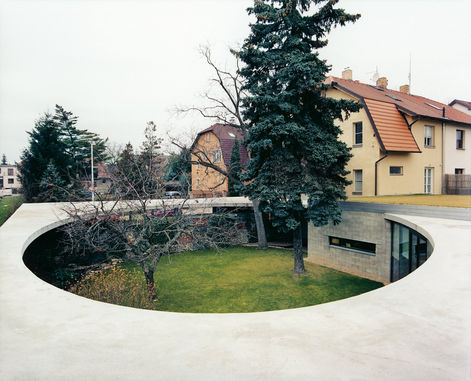 """The tension between old and new is easy to see in Prague, where Art Deco housing butts up uncomfortably with utilitarian tower blocks left behind after the Soviet invasion of 1968. Even the homeowners' attitude reflects this. """"I'm used to that antique style and always thought I would live like that,"""" Johana Ru˚žičková explains. """"I know that conflict.""""  Imaginative Round Homes by Robert Gordon-Fogelson from EggO Centric"""