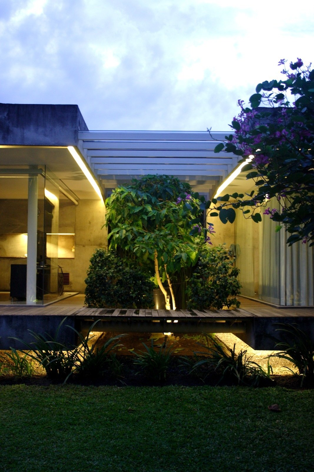 """A wider view of the bridge that """"will strengthen the floating concept of this house,"""" according to Wibowo.  Modern Homes Built Around Trees by Jacqueline Leahy"""